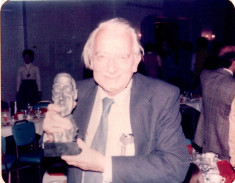 Manly Wade Wellman with his World Fantasy Award, 1975